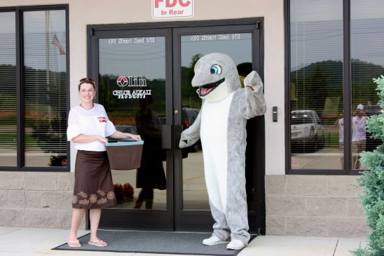 Suzanne Wisdom (Oceana) and the Oceana dolphin deliver the petition cards to the Olin offices.