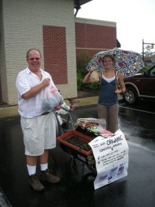 Farmer's Market folks - getting some grapes, giving to a good cause (World Bicycle Relief)