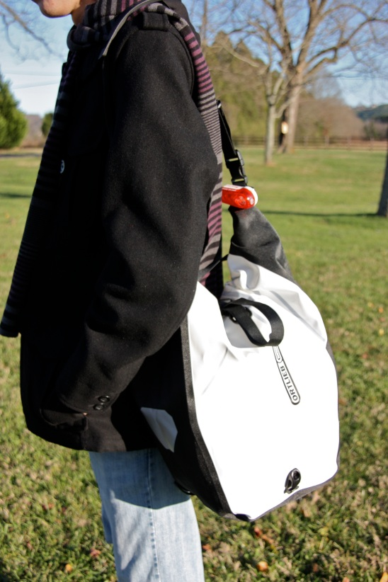 Off bike, carrying with the shoulder strap